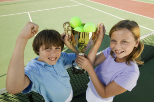 Brother and Sister with Tennis Trophy